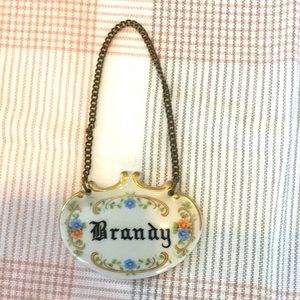 """Vintage porcelain """"Brandy"""" decanter tag"""